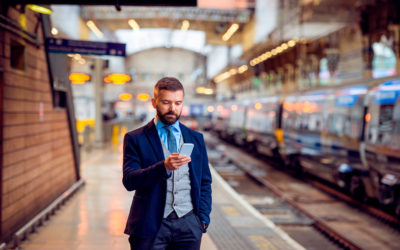 Man holding smartphone. He uses an app that tracks calls and emails to Salesforce